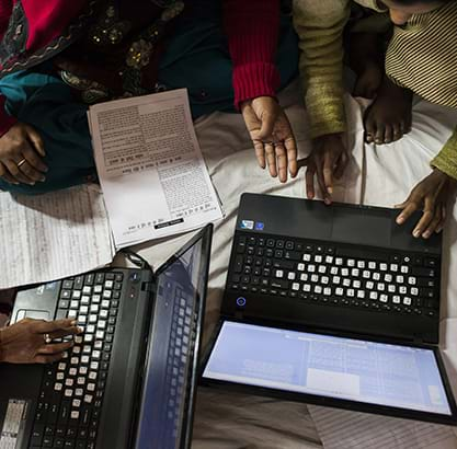 Village journalist women work together on their special report issue on the issue of violence against women during a workshop in Chitrakoot, Uttar Pradesh, India. 2012. Photo Credit & (c): Suzanne Lee.