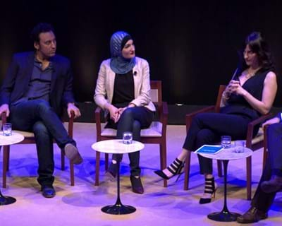 In conversation: Aasif Mandvi, Lilliam LaSalle, Mik Moore, Linda Sarsour, Eric Ward. This image is available under the 4.0 Creative Commons license.