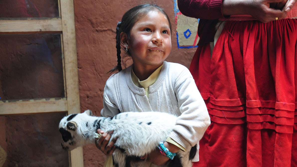 Young girl with her goat. This image is available under the 4.0 Creative Commons license.