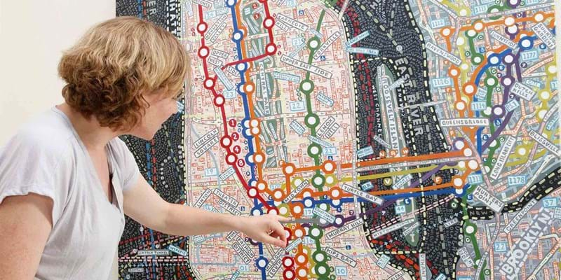 Woman with hand drawn map of Manhattan. This image is not available under the 4.0 Creative Commons license.