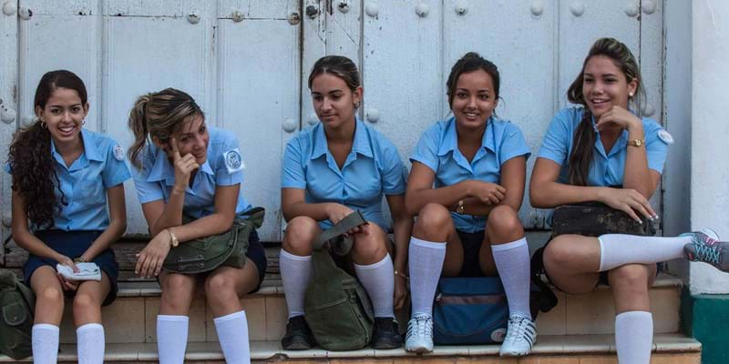 School girls sitting on step in historical center. 2014, Photo Credit & (c) Jayne Sweeney / AWL Images