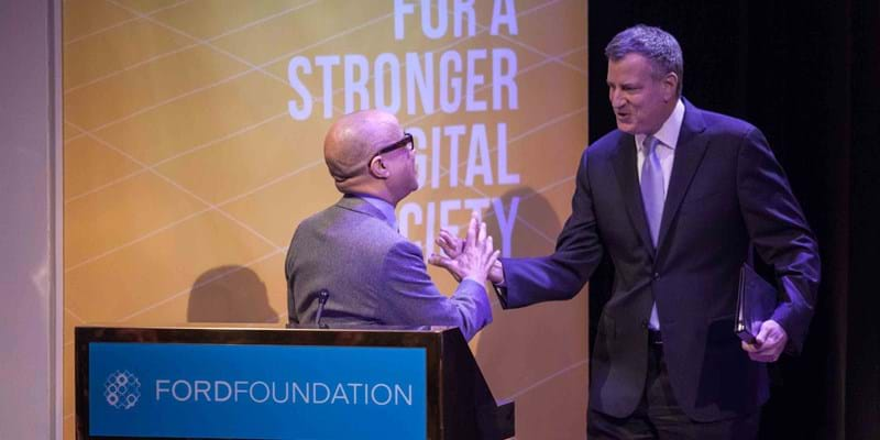 Mayor Bill deBlasio greets Darren Walker at the NetGain event. 2015, Photo Credit & (c): Martin Dixon