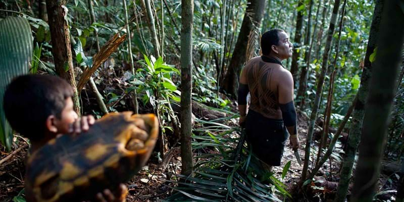 Indigenous people walking in forest. Photo Credit: Yoni Brooks (c) Ford Foundation