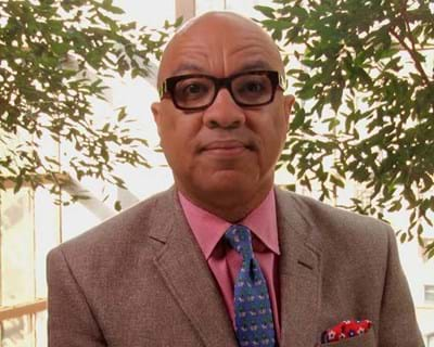 Darren Walker speaks to attendees of the 2014 International AIDS conference in a video message. This image is unavailable under the 4.0 Creative Commons license.
