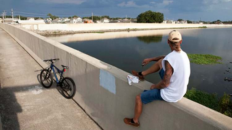 Dean Marshall looks at the 17th Street Canal and floodwall. New Orleans, LA. July 18, 2015. Photo credit & ©: Corbis/Philip Gould