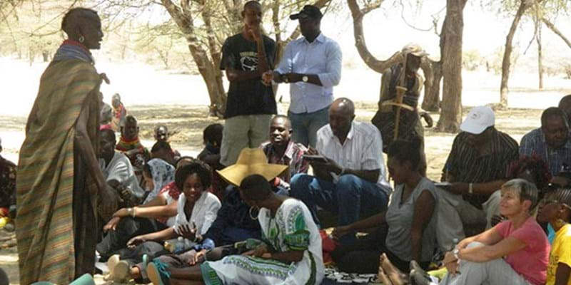 Several Ford staff attend a community meeting in Kenya's Turkana County. Kenya, Africa. August 2015. Photo credit & (c): Ford Foundation.