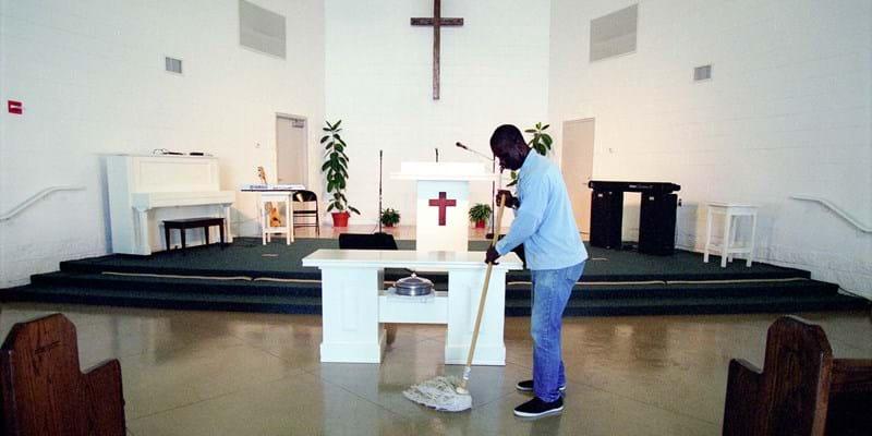 Incarcerated person mops the floors of the prison church. Louisiana, USA. Photo Credit & (c): kadir van lohuizen/ NOOR