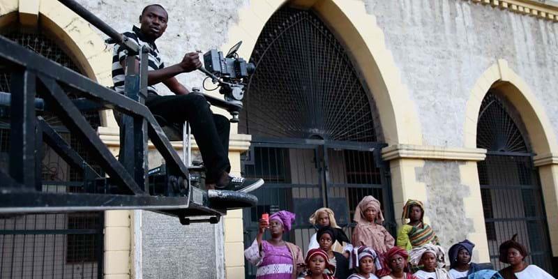 "A cameraman films a scene from a crane during the making of ""Ake."" Nigeria, Africa. 2013. Photo Credit & (c): Akintunde Akinleye/Corbis"