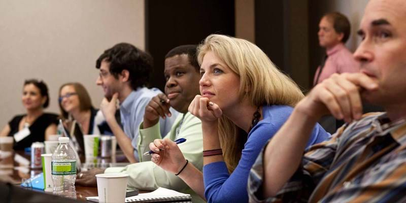 Ford staff members deliberate questions during a strategy session. 2012. New York, NY. Photo credit & (c): Ford Foundation