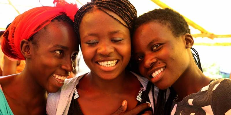 Three young women laughing together