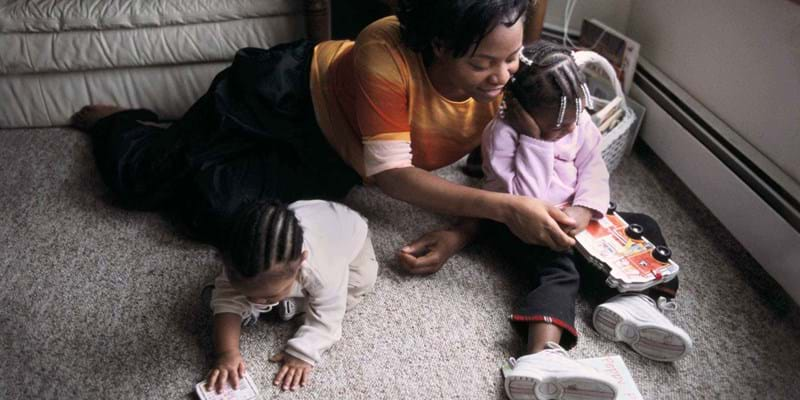 A woman and her children living in the Jeremiah Project. Minneapolis, Minnesota. 2011. Photo credit: © National Geographic
