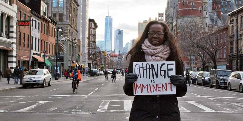 Young woman holding sign to protest against police brutality and racial inequality. New York. 2014. Photo credit: Dean Neistat/Polaris/Newscom