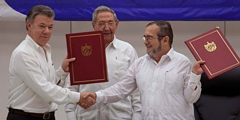 Colombian president Juan Manuel Santos, Cuban president Raúl Castro and Farc commander Timoleón Jimenez attend the signing ceremony. Havana, Cuba. 2016. Photo credit: CEET/Newscom