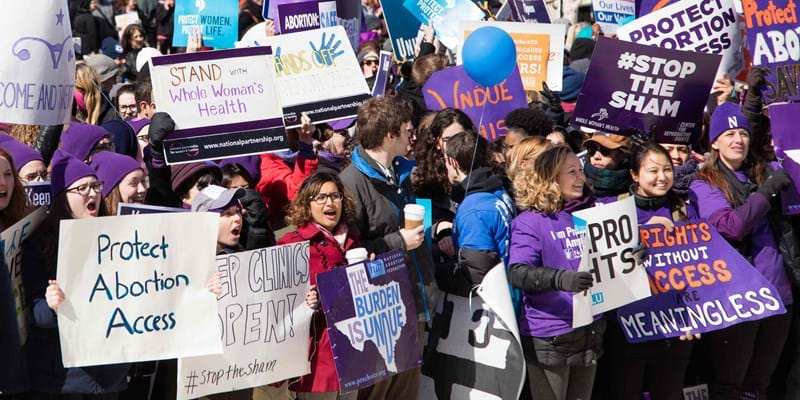 Demonstrators assembled in front of the U.S. Supreme Court steps. Washington, D.C. March, 2016. Photo credit: Jeff Malet Photography/Newscom