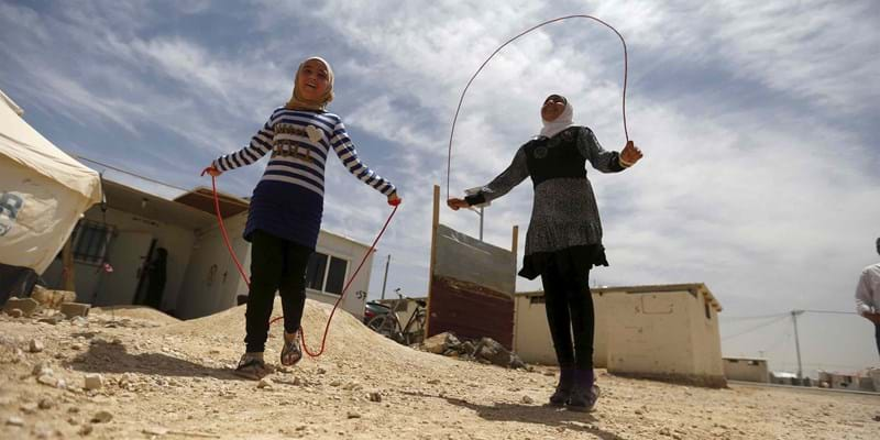 Syrian refugee Omayma al Hushan, 14, who launched an initiative against child marriage among Syrian refugees, plays with her friend. Photo credit: REUTERS/Newscom