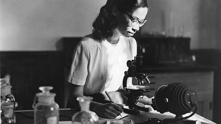 Young woman working in lab and benefiting from United Negro College Fund. 1953. Photo Credit: © Ford Foundation