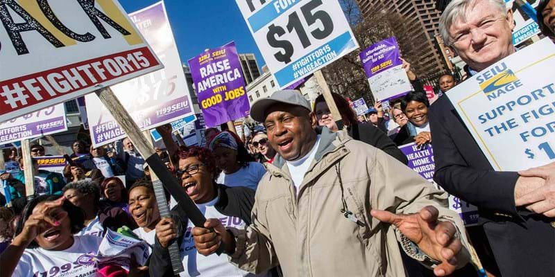 Workers rally and march through the streets for fair wages. Boston. 2016. Photo credit: Marilyn Humphries/Newscom