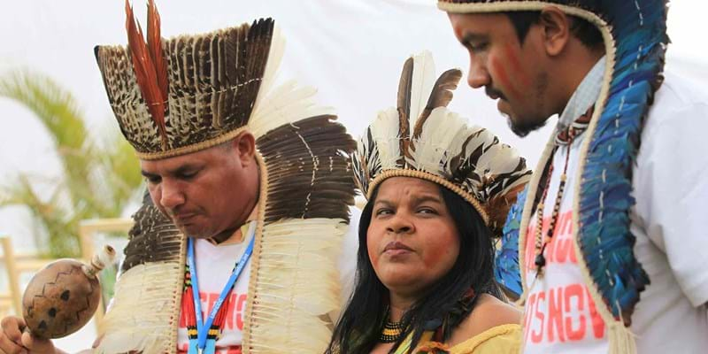 Brazilian native leader Sonia Bone Guajajara participates next to other members of her community during a protest at the summit of climate change (COP20). Lima, Peru. 2014. Photo credit: Paolo Aguilar/EFE/Newscom
