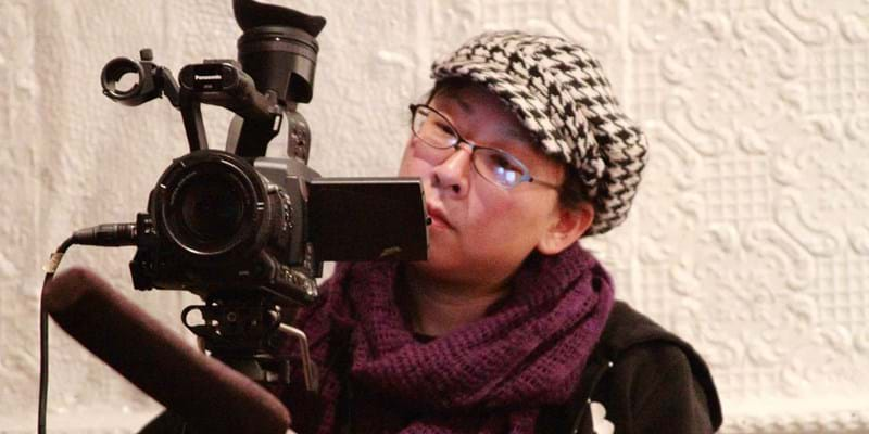 Documentary filmmaker at work. 2010. Photo credit: Flickr user UNIONDOCS
