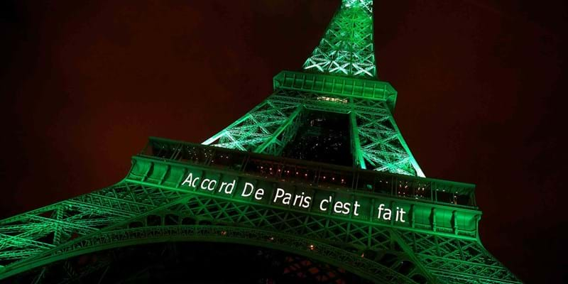 "The Eiffel tower is illuminated in green with the words ""Paris Agreement is Done"", to celebrate the Paris U.N. COP21 Climate Change agreement. Paris, France. November, 2016. Photo credit: REUTERS/Jacky Naegelen"