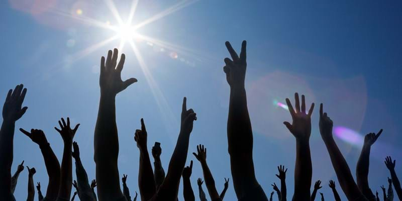 Hands in the air. Photo credit: Paul Taylor/Getty Images