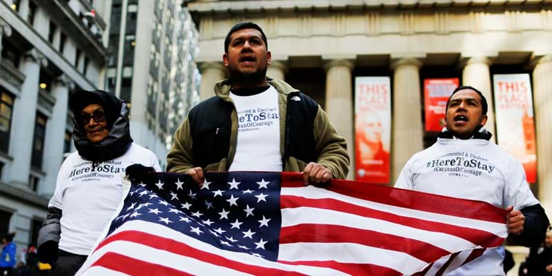 "People known as ""Dreamers"" march outside a Trump building to launch the ""Caravan of Courage"" on November 22, 2016 in New York.  The group will march and make stops to connect with communities in New Jersey, Pennsylvania, and Maryland after their departure in New York (Photo credit: EDUARDO MUNOZ ALVAREZ/AFP/Getty Images)"