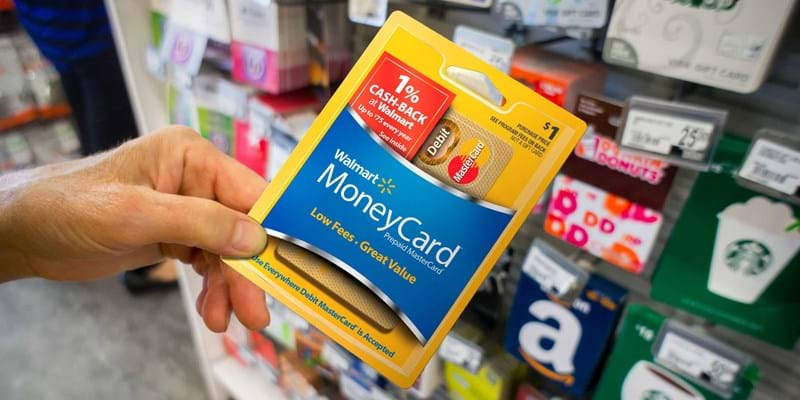 A shopper chooses a prepaid card in a store. Photo credit: RICHARD B. LEVINE/Newscom