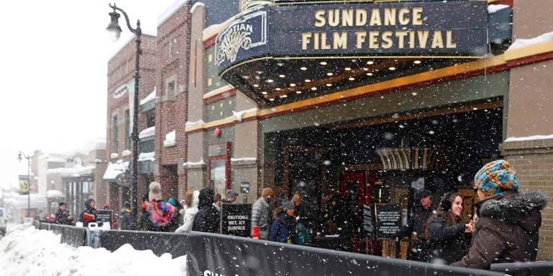 Snow piles up as people walk past the Egyptian Theater at the 2017 Sundance Film Festival. Park City, Utah. Photo credit: EPA/Newscom