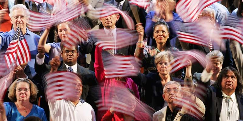 People waving American flags. Photo credit: Getty Images