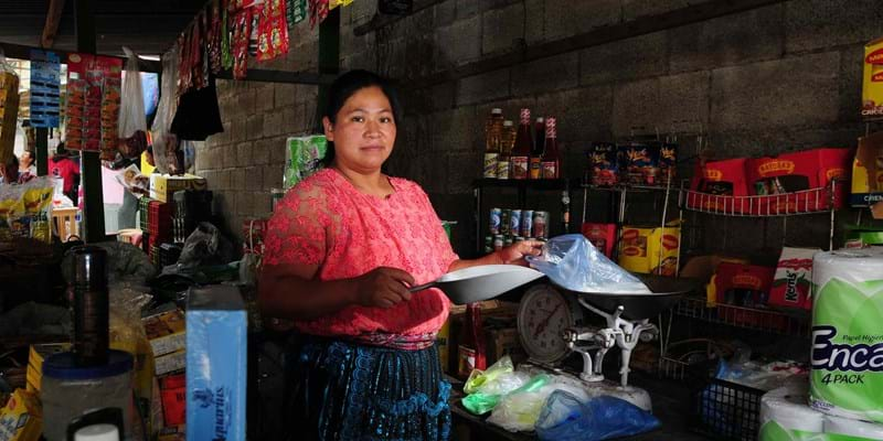 A woman attends her post in a market in zone 3, Guatemala City. Guatemala. Photo credit: Maria Fleischmann / World Bank