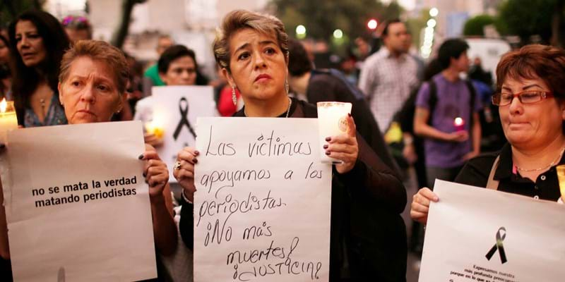 Women protesters are holding signs in Mexico city after a journalist was murdered. Credit: Miguel Tovar/STF