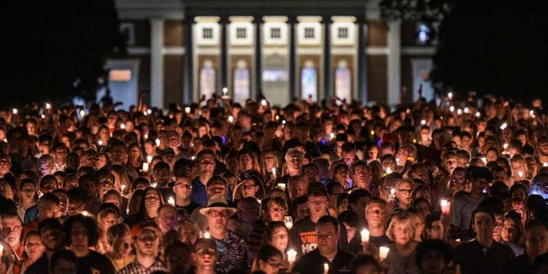 Hundreds of people march peacefully with lit candles across the University of Virginia campus (Photo by Salwan Georges/The Washington Post via Getty Images)