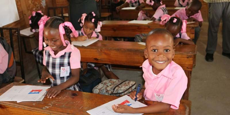 Young African students in a classroom.