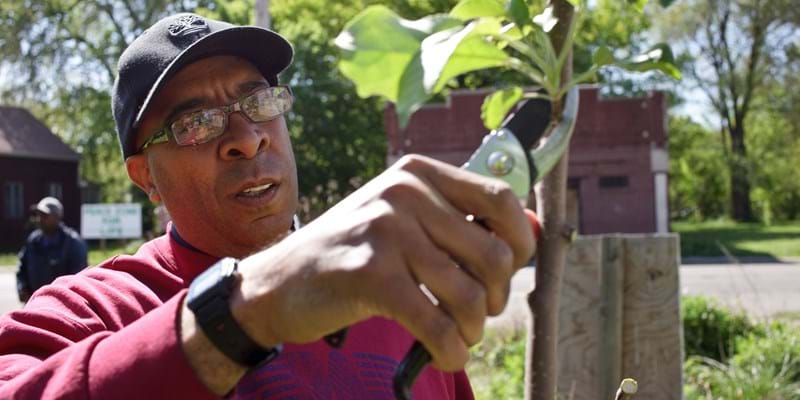 """Michael Wimberley, founder of the volunteer organization """"Friends of Detroit,"""" in a section of East Detroit he nicknamed the """"Hope District."""" """"Friends of Detroit"""" was founded by Michael Wimberley, a former journalist, and has tried to turn abandoned lots into public gardens and parks. (Photo by James Leynse/Corbis via Getty Images)"""