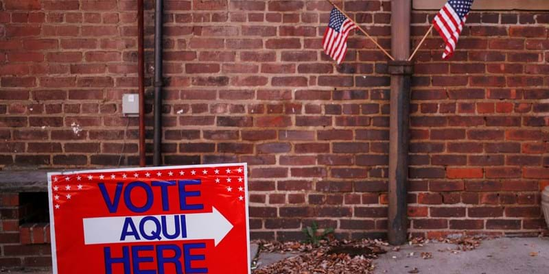 Signage and American flags are displayed outside an American Legion Post on Election Day. Photographer: Luke Sharrett/Bloomberg via Getty Images