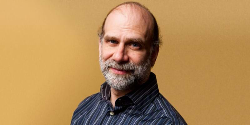 Cybersecurity expert Bruce Schneier against a gold background
