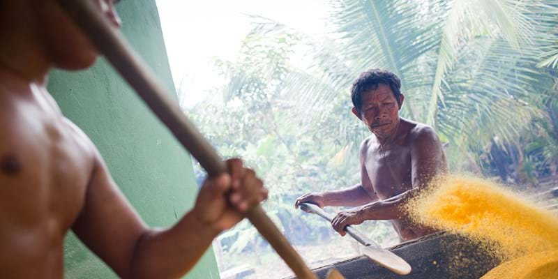 Joaqrum Sampaio works at the Manioc grinding building, near Rio Preta da Eva in Amazonas, Brazil.