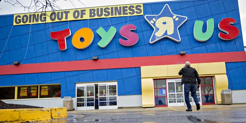 A shopper walks towards the entrance of a Toys R Us Inc. retail store in Frederick, Maryland, U.S., on Monday, April 16, 2018. Credit: Andrew Harrer/Bloomberg via Getty Images