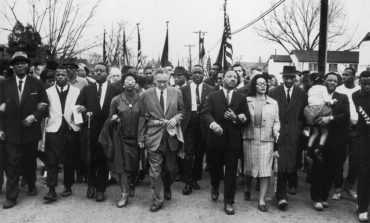 American civil rights campaigner Martin Luther King and his wife Coretta Scott King lead a black voting rights march from Selma, Alabama, to the state capital in Montgomery.