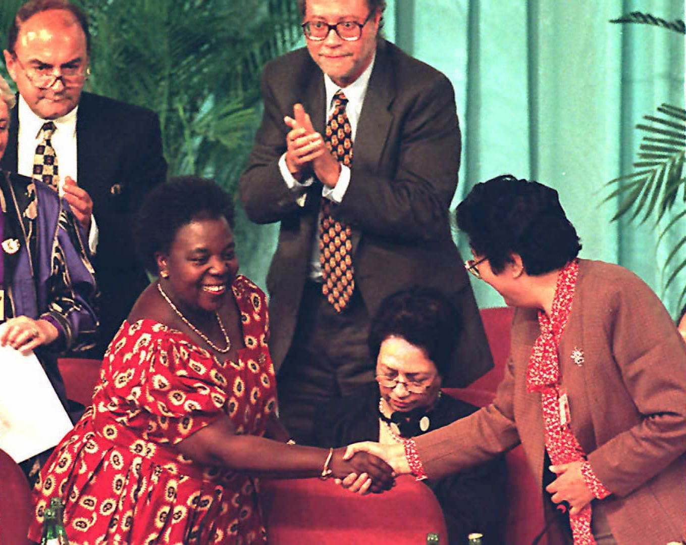Fourth World Conference on Women Secretary General Gertrude Mongella (L) and conference President Chen Muhua (R) shake hands during the closing ceremony of the 12-day conference 15 September.
