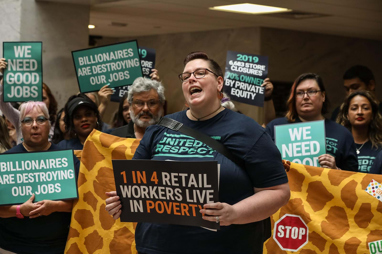 "Protestors push Toys ""R"" Us to prioritize laid-off employees in rehires, rethink the layout of new stores, and institute a $15 minimum wage."
