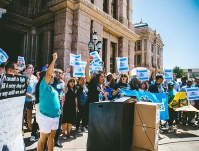 Local Progress members from across the country rally at the Texas State Capitol in 2017 in opposition to the anti-immigrant law SB 4. Photo credit: Bryan C. Parker / Local Progress